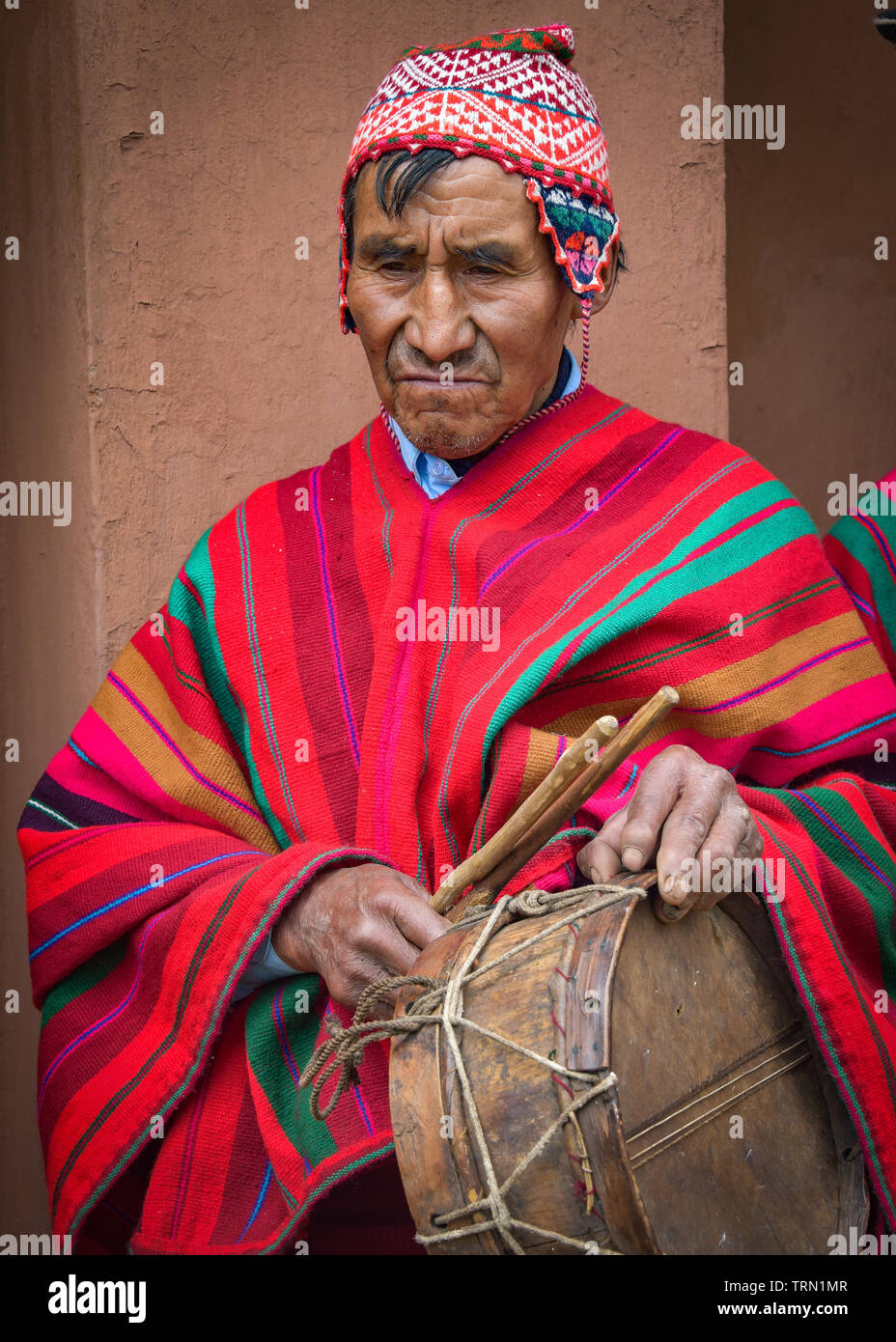 Sacred Valley, Cusco, Peru - Oct 13, 2018: An indigenous Quechua man in traditional dress and drum - Stock Image