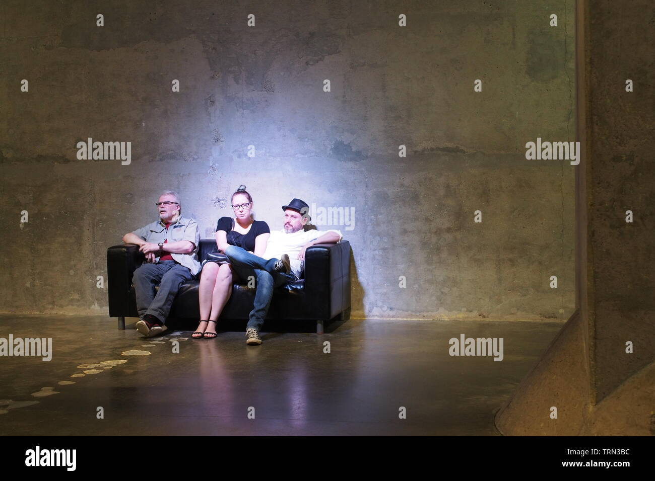 Visitors relax on a couch in the Bank of Canada gold vault, deep within the Diefenbunker, Canada's Cold War Museum, Carp, Ontario, Canada. - Stock Image