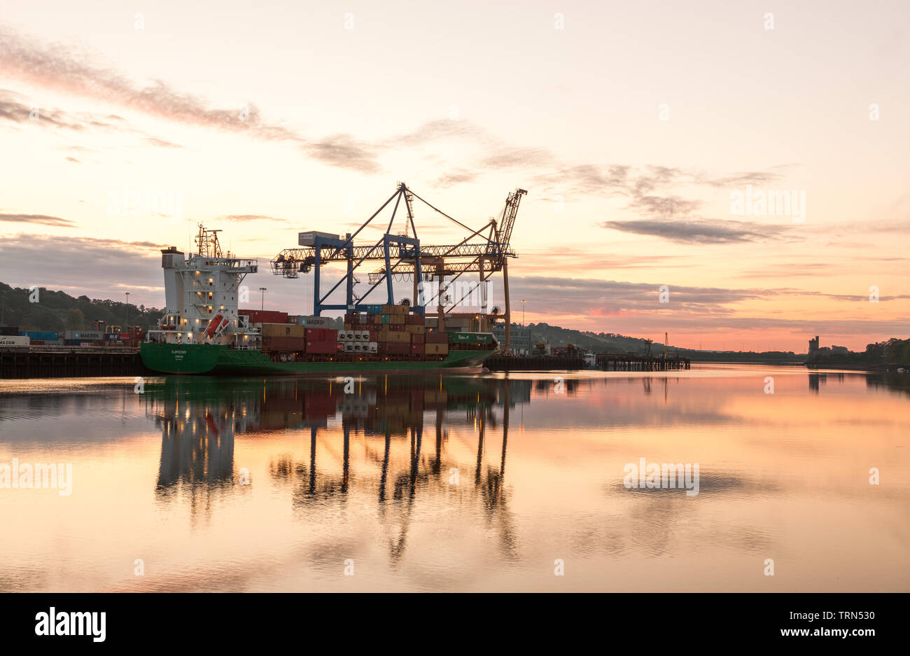 Tivoli, Cork, Ireland. 10th June, 2019. A bright summer's morning as the cargo ship Elbffeder  loads containers for export before sunrise at Tivoli Docks in Cork, Ireland. Credit; David Creedon / Alamy Live News - Stock Image