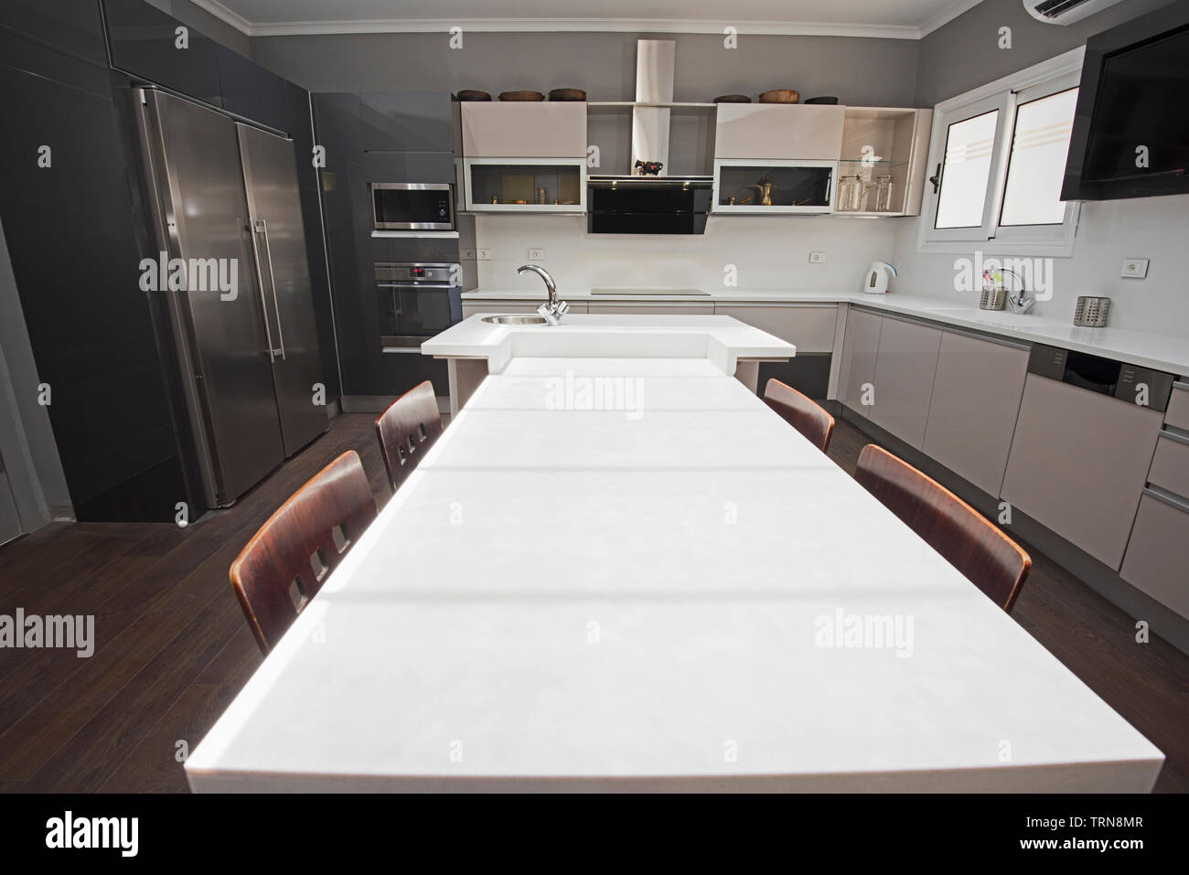 Interior Design Decor Showing Modern Kitchen With Cupboards In Luxury Apartment Showroom Stock Photo Alamy