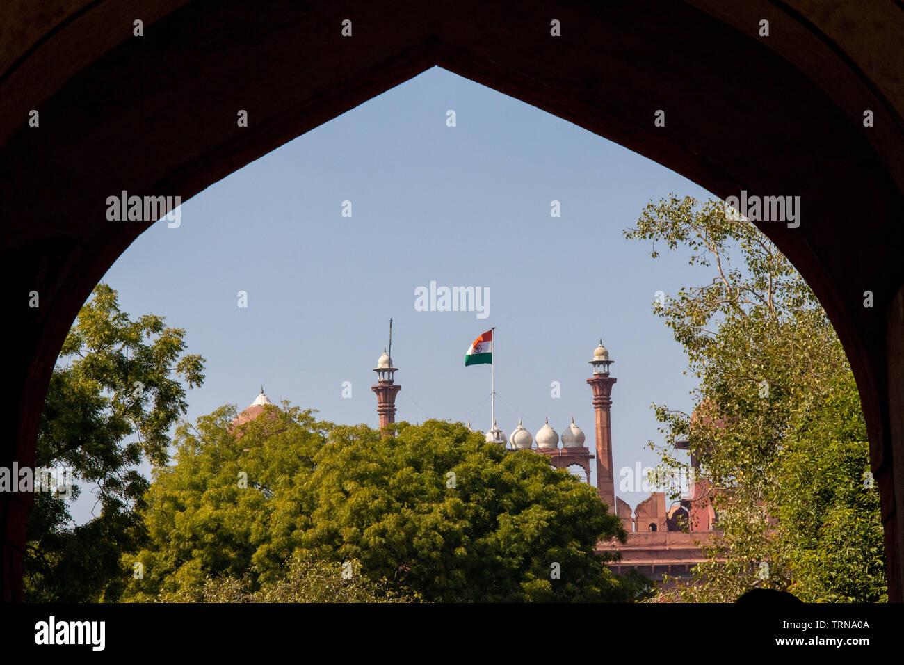 Red Fort Delhi, India framed through a inside curved entrance gate. - Stock Image