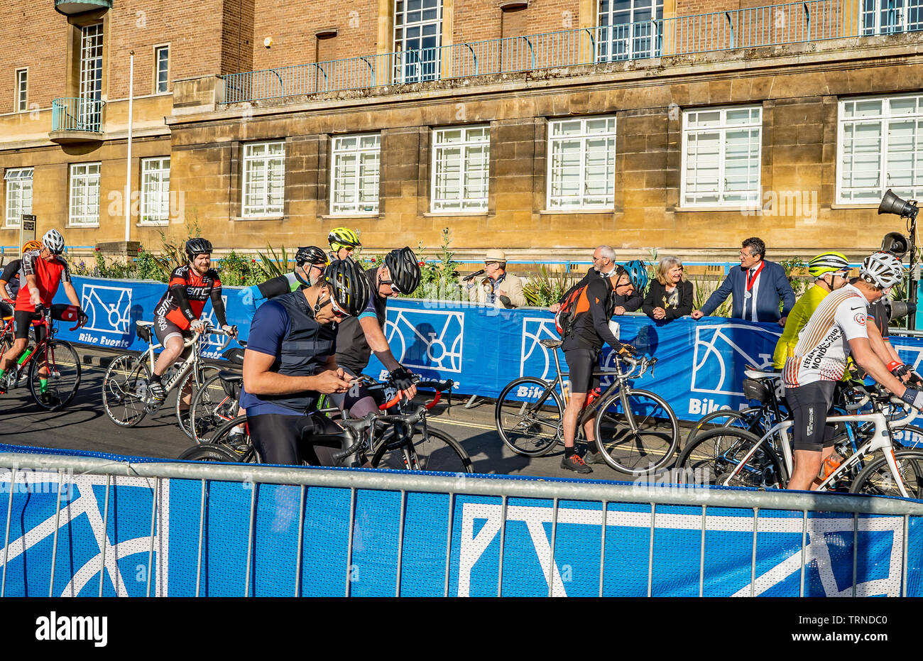 June 2019, Norwich 100 bike ride:  Cyclists at the start of the cycling event waiting to embark on the one hundred mile tour of Norfolk - Stock Image