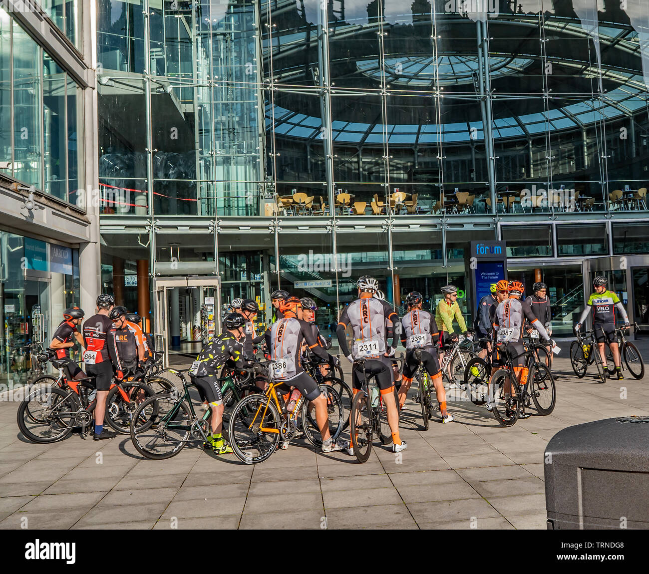 June 2019, Norwich 100 bike ride: Bike club members outside the front of the Forum waiting to be called up to the start gate to embark on the one hund - Stock Image