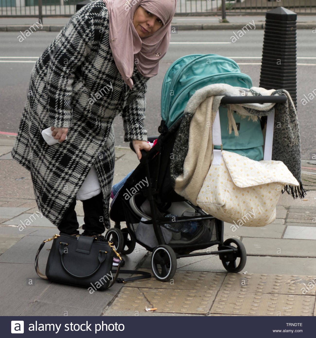 Europe, UK, London, 2018: View Of Muslim Woman With Baby In Pram Stock Photo