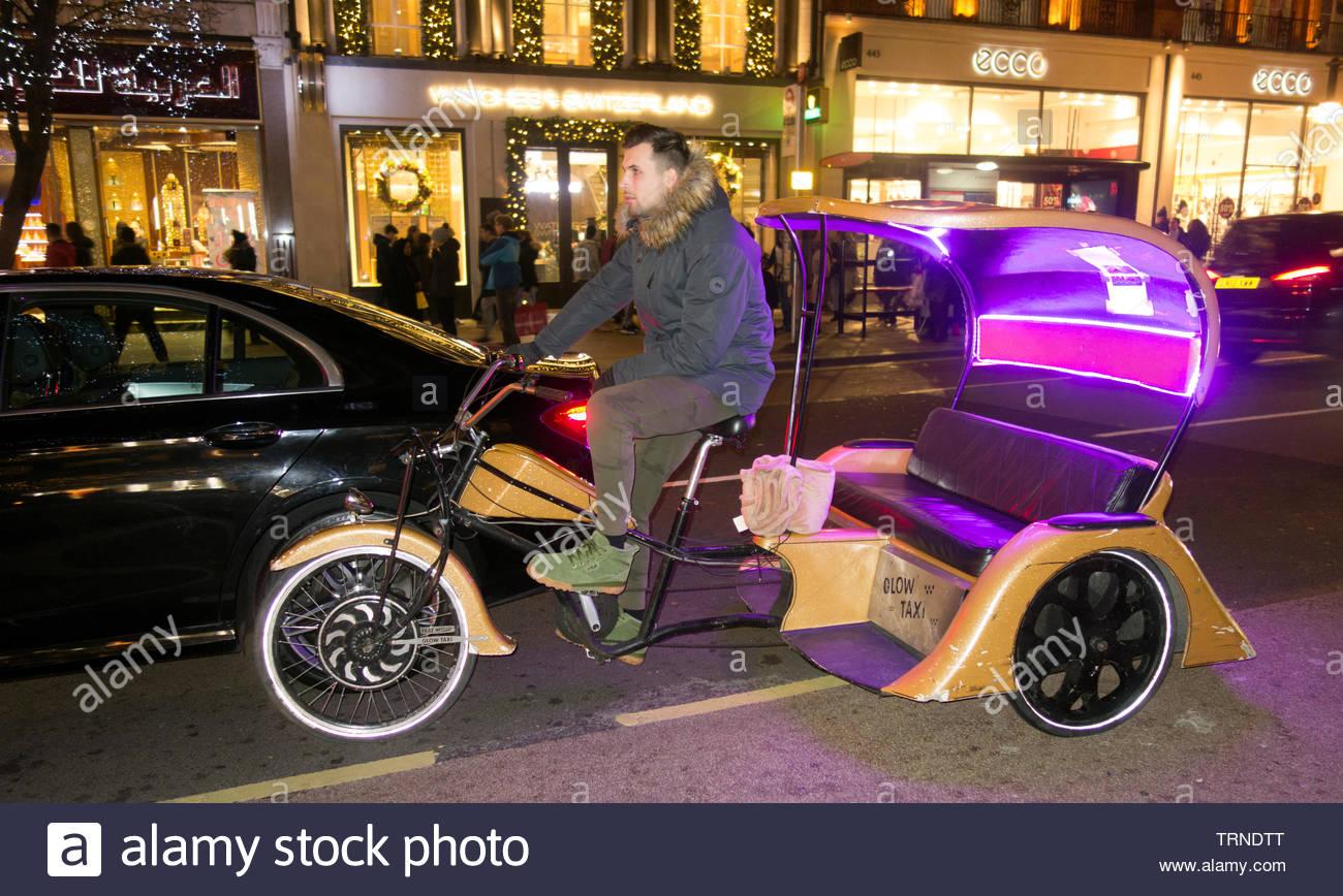 Europe, UK, London, 2018: View Of Rickshaw Taxi Bike, Oxford Street - Stock Image