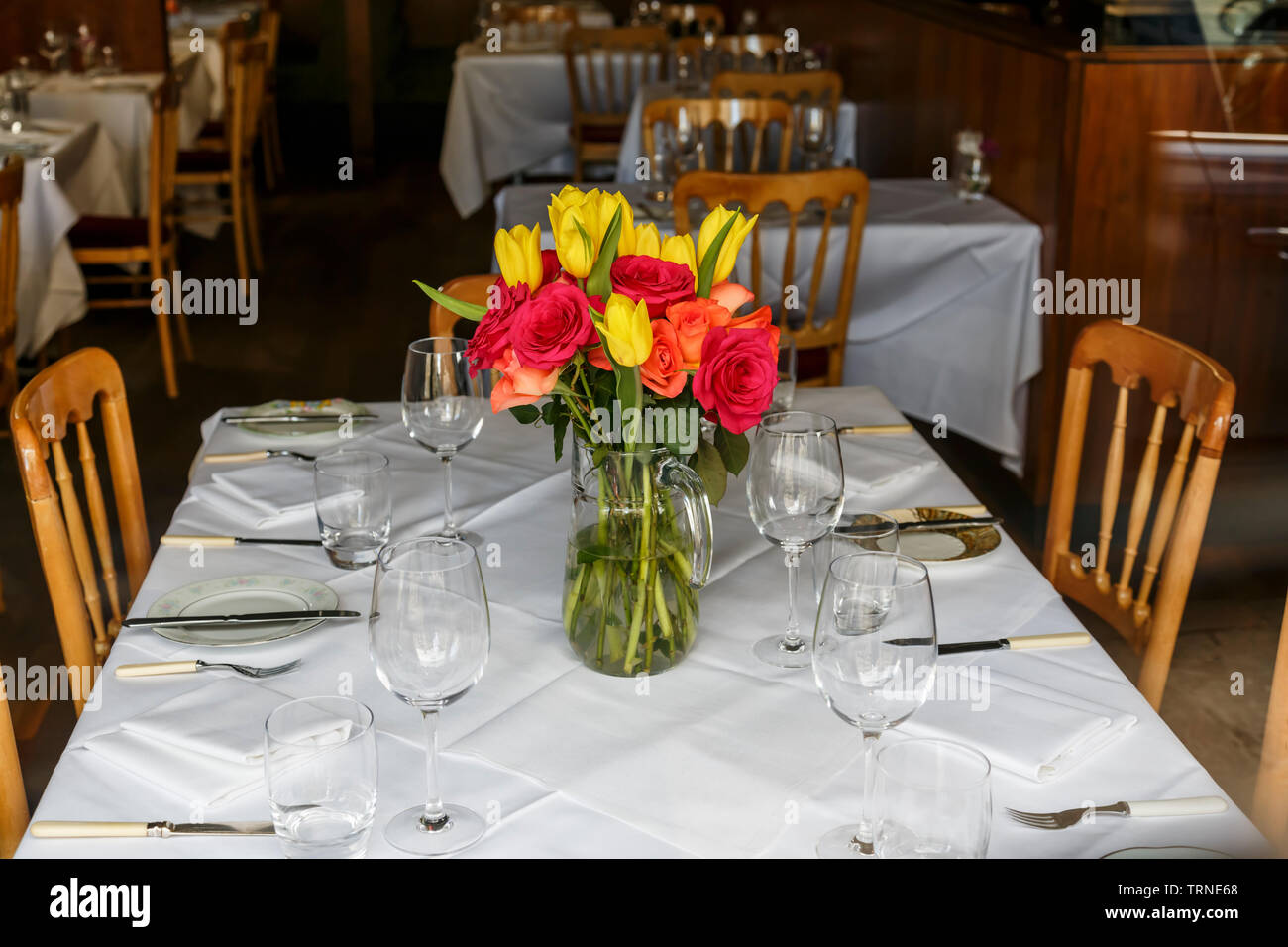 Flowers on a table in the twofatladies restaurant on Blythswood Street in Glasgow city centre, Scotland, UK - Stock Image