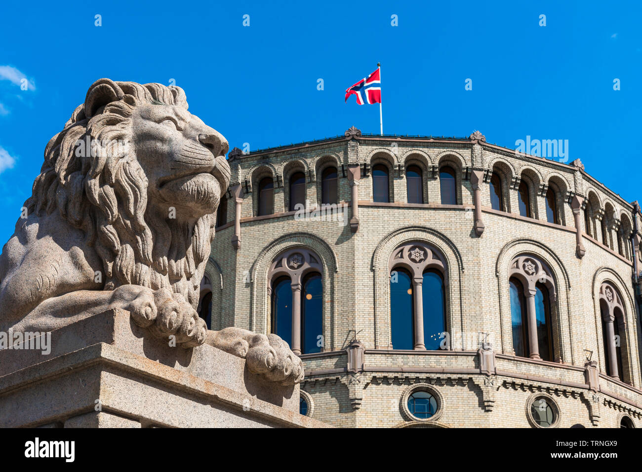 Parliament Oslo, view of a lion statue sited in front of the Norwegian Parliament building in Oslo. Stock Photo