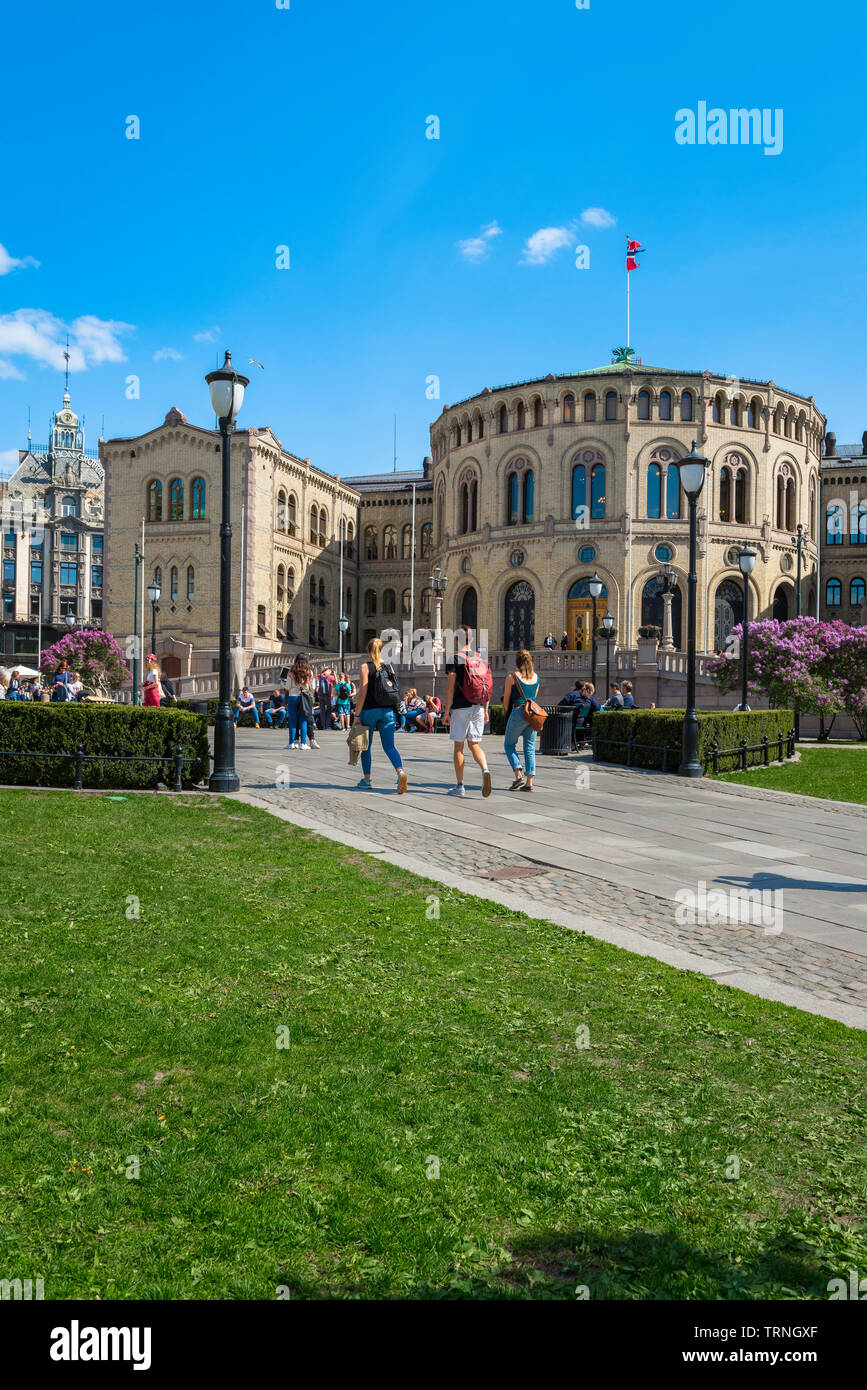 Oslo Parliament building, view in summer of young people walking towards the Norwegian Parliament Building (Stortinget) in Oslo city center, Norway. Stock Photo