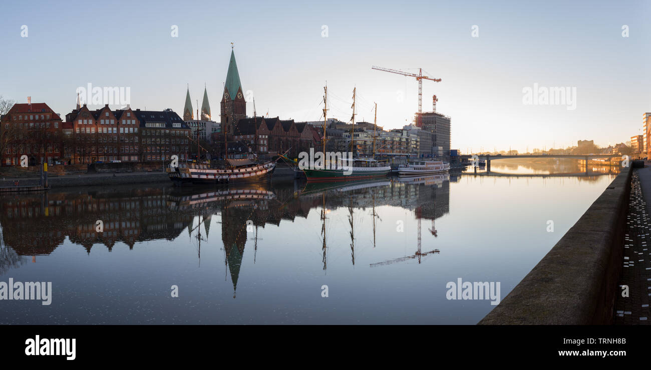 Panorama of Bremen at the Schlachte, St. Petri Dom, ships at sunrise Stock Photo