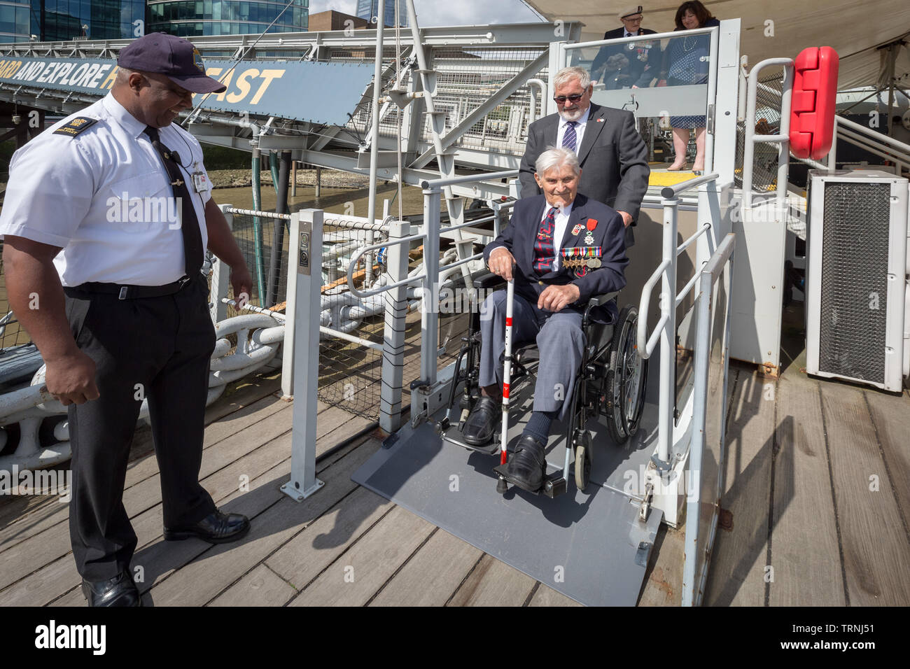 London, UK. 6th June 2019. Imperial War Museum marks 75th anniversary of the D-Day landing on board HMS Belfast. D-Day veterans (Arthur Barnes in chair) from Blind Veterans UK board the HMS Belfast, the ship that led the Allied fleet on D-Day. Credit: Guy Corbishley/Alamy Live News Stock Photo