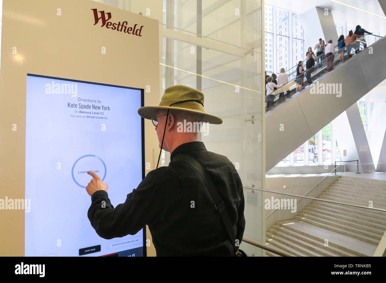 Senior Man Using Touchscreen Directory Panel at Westfield World TradeCenter Shopping Complex, NYC, USA - Stock Image