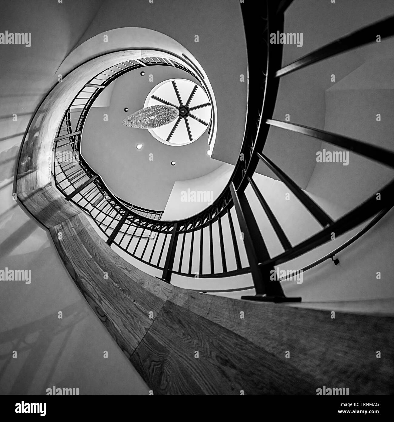 A spiral staircase wraps upward in an extreme helix - Stock Image