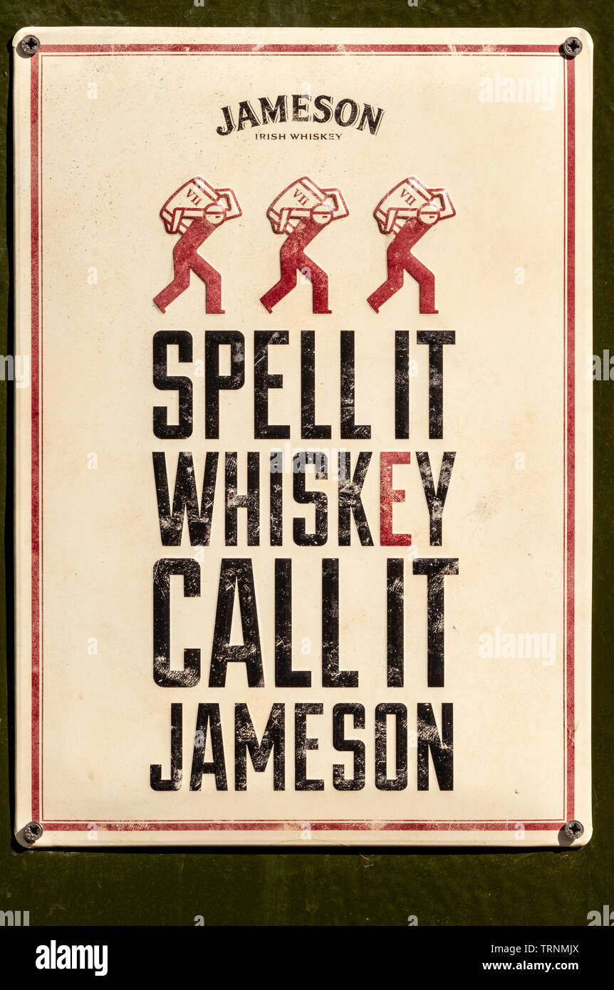 Spell it whiskey call it Jameson enamel sign - Jameson whiskey advertising vintage sign board. - Stock Image