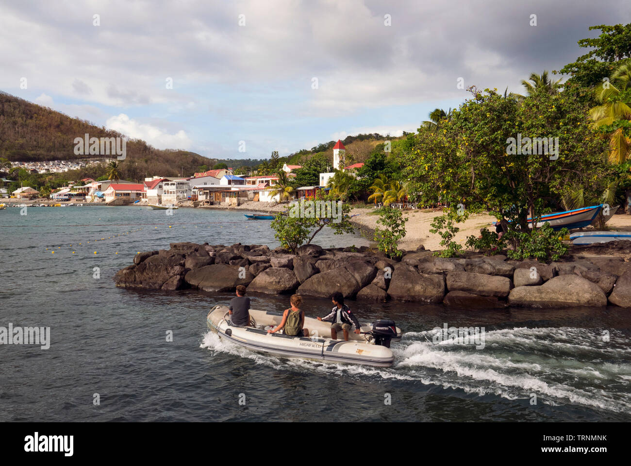 """Pretty Bay and town of Deshiaes in Basse Terre  Guadeloupe. Location for """"Death in Paradise"""" TV series Stock Photo"""
