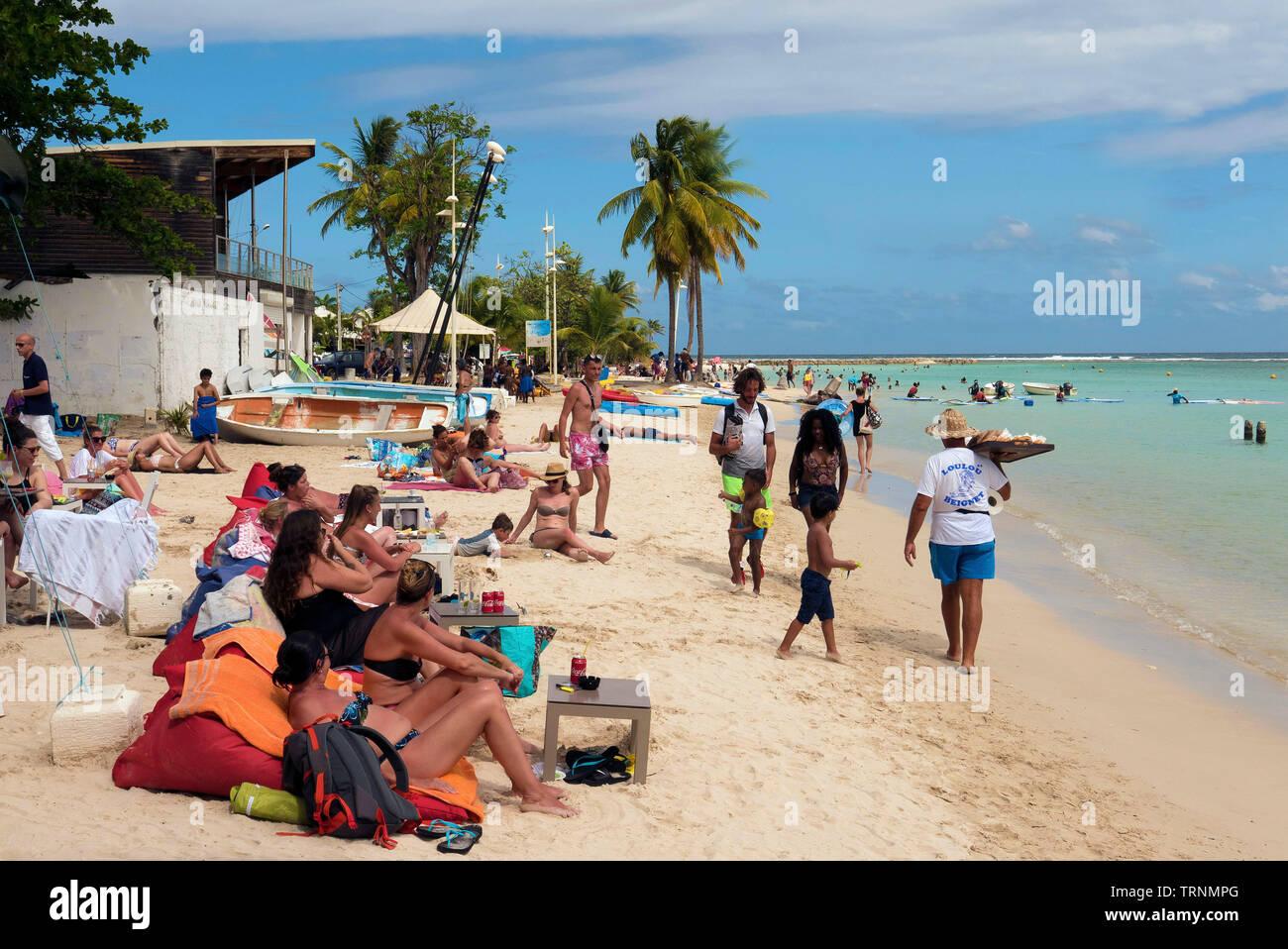 Sunbathers on Saint Anne beach in Basse-Terre Guadeloupe Stock Photo