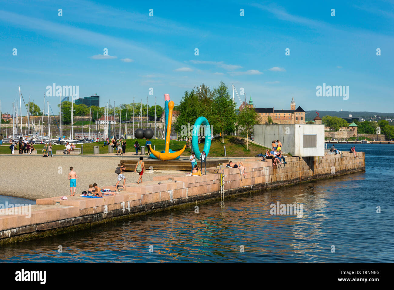 Oslo beach, view of people relaxing on Tjuvholmen City Beach in the harbour area of Oslo, Norway. Stock Photo