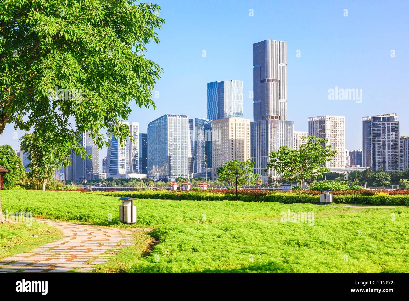 Cityscape and skyline of Fuzhou from green field in park,Fuzhou,China - Stock Image