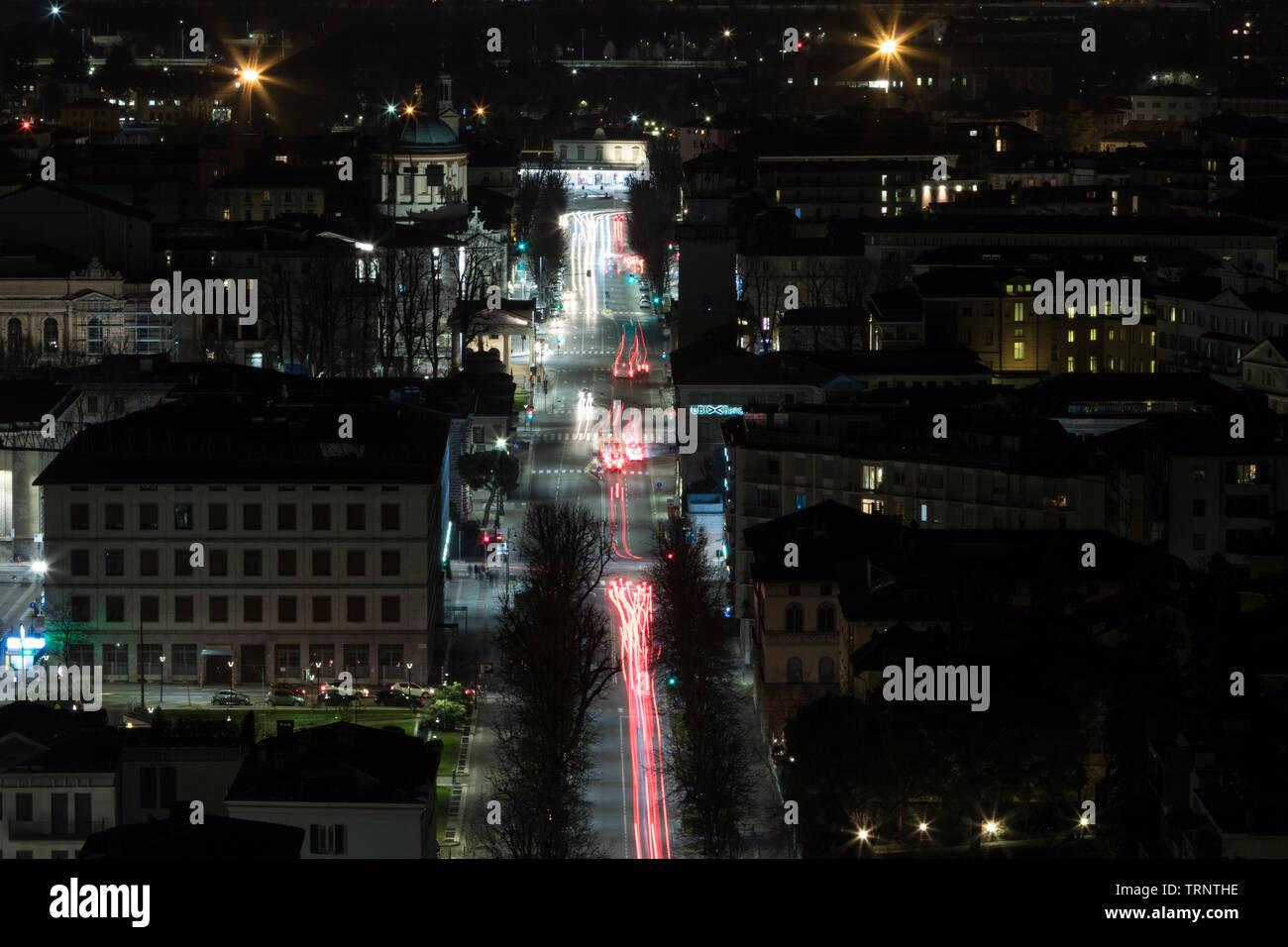 Cityscape of Bergamo, Lombardy, 14 march 2019, bergamo night view seen from Città alta walls. - Stock Image