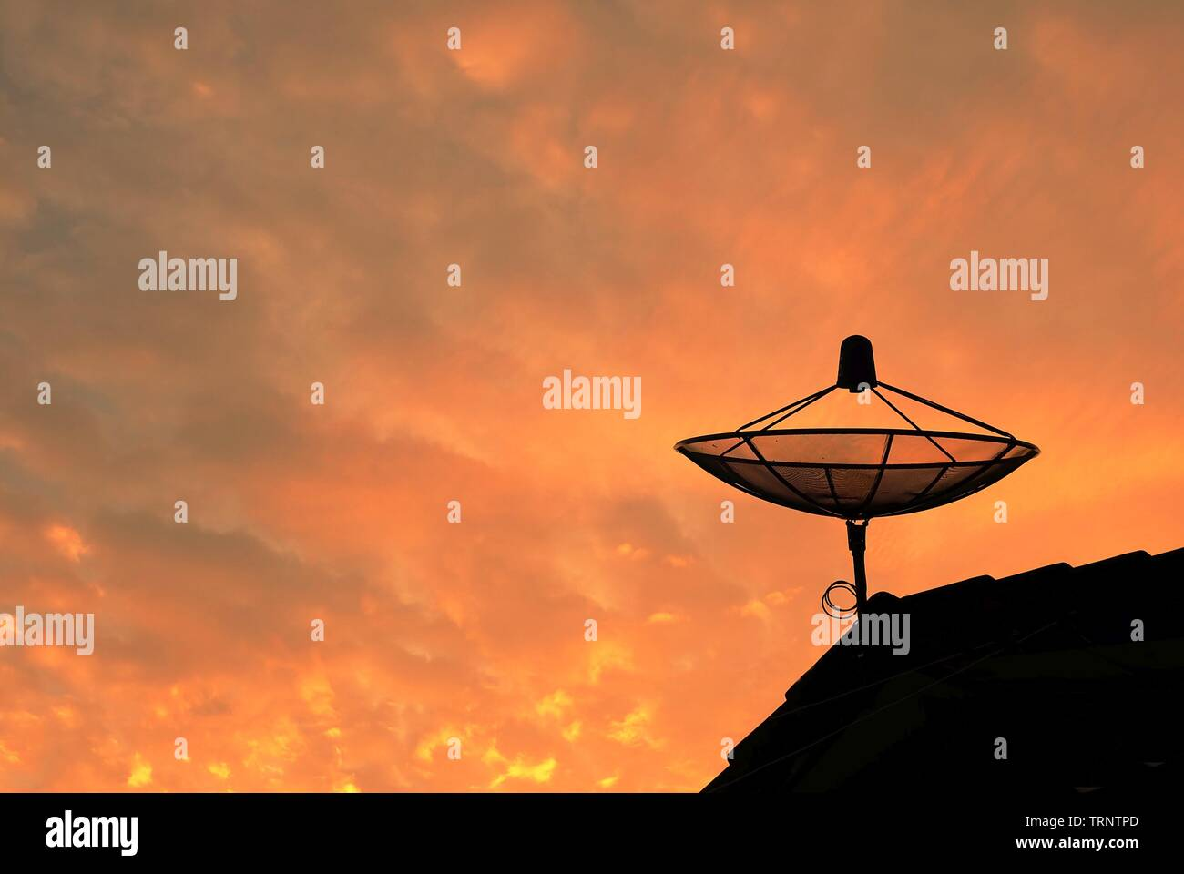 Parabola Satellite Dish Antenna Receiver Against on Blue Sky for Communication and Media Industry, Symbolizing Global Communications. - Stock Image