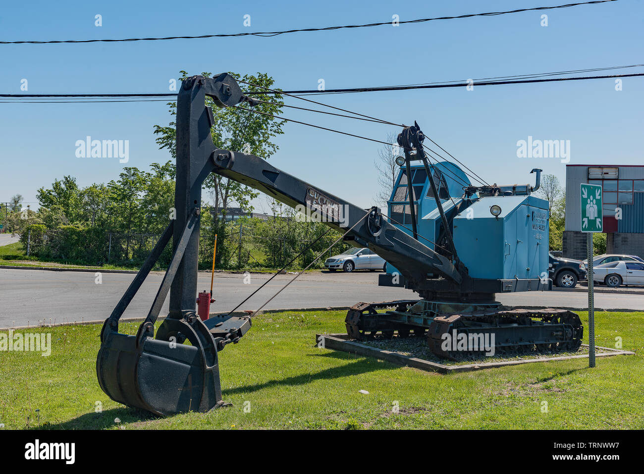 Old Excavator-Digger used as advertising. - Stock Image