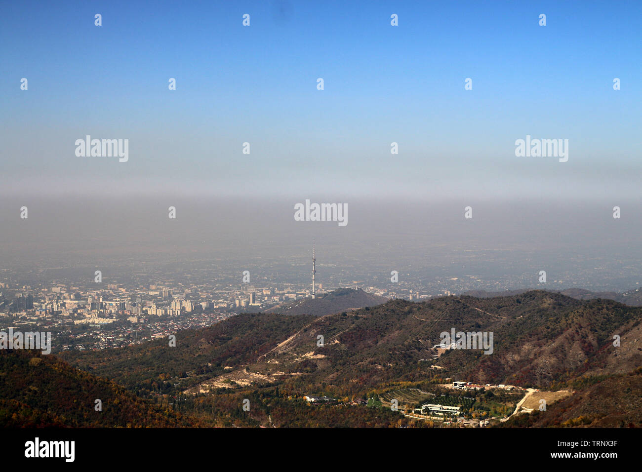 View of Almaty from above with clearly seen sea of smog Stock Photo