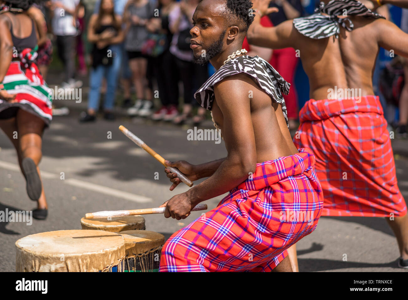 The street parade is the highlight of Carnival of Cultures during Pentecost weekend in Berlin. - Stock Image