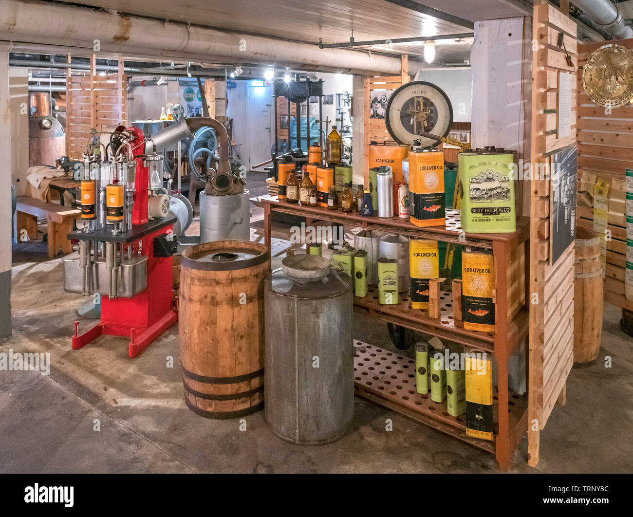 Display of machinery for making Cod Liver Oil, Fisheries Museum, Ålesund, Møre og Romsdal, Sunnmøre, Norway - Stock Image