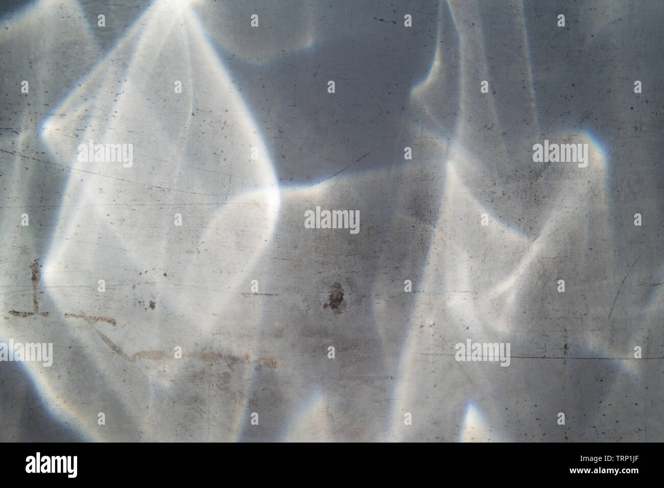 Sun rays distorted by glass on ceramic plates. - Stock Image