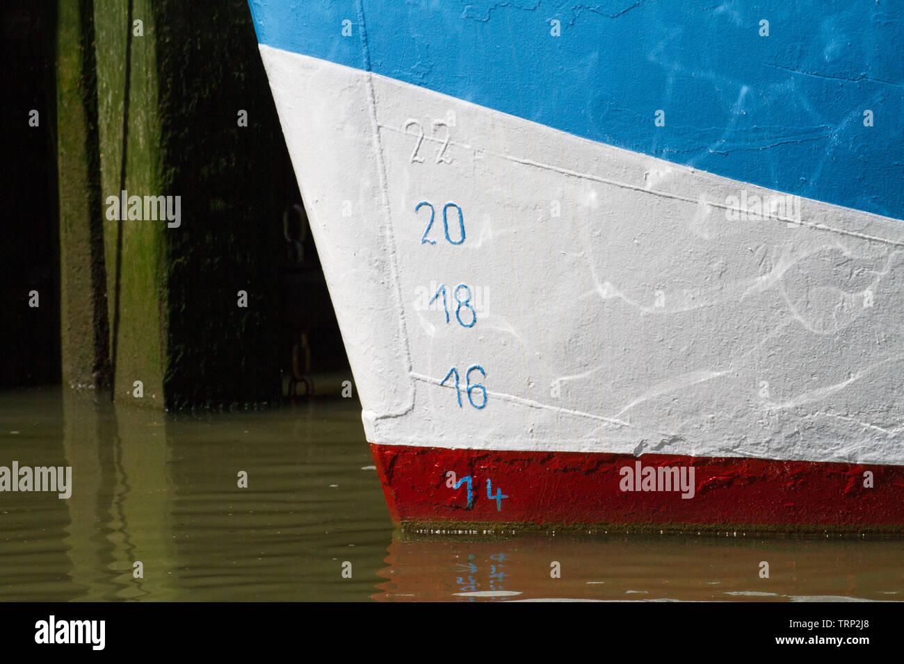 Loading markings on hull of fishing boat. Germany. - Stock Image