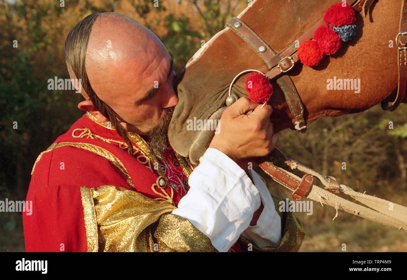 Zaporizhia Cossack says goodbye to  his faithful friend horse, Ukraine; Zaporizhia; Zaporizhian Sich - Stock Image