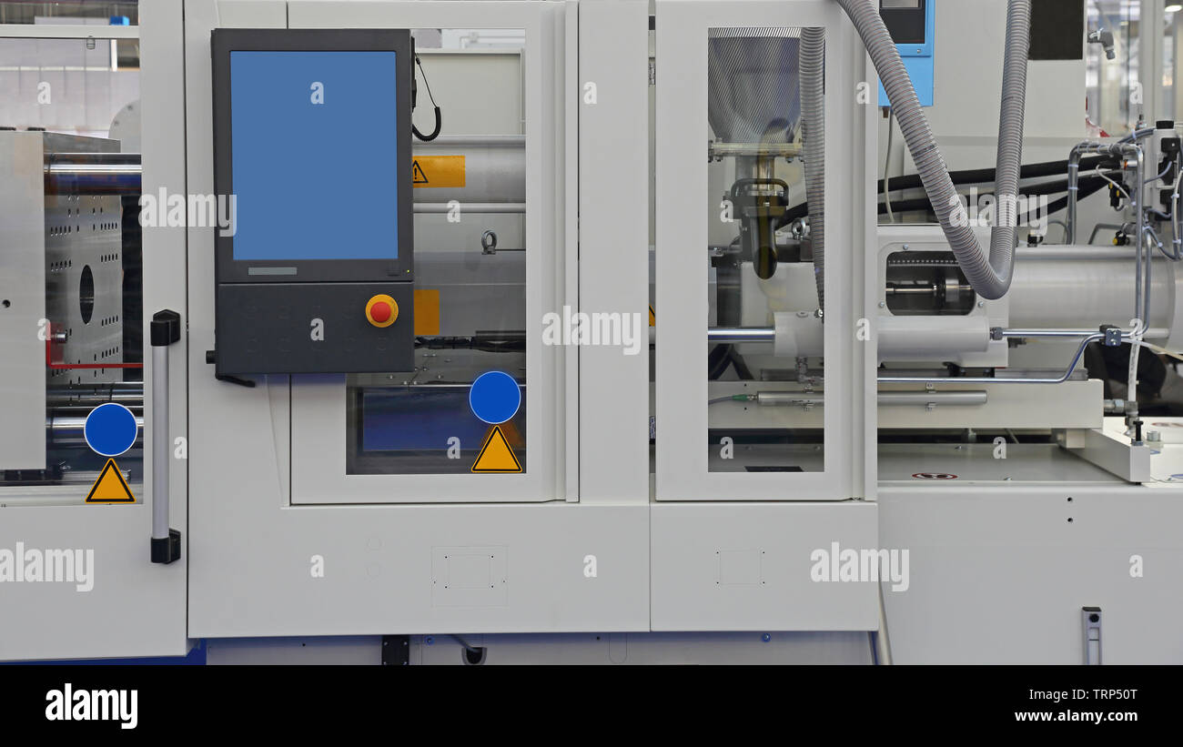 Injection Molding Machine for Plastic Parts Manufacturing Production - Stock Image