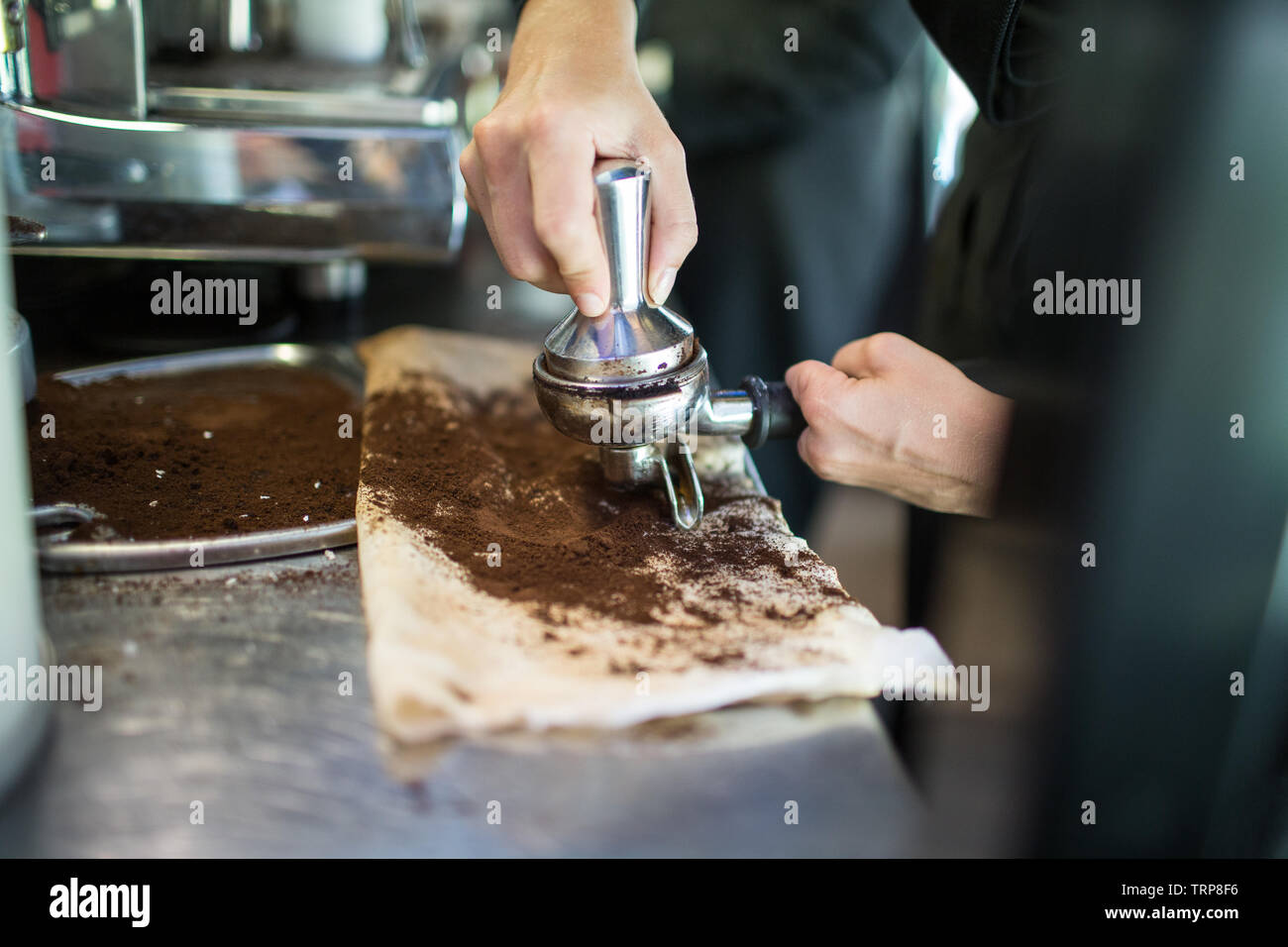 Barista with disability making coffee Stock Photo
