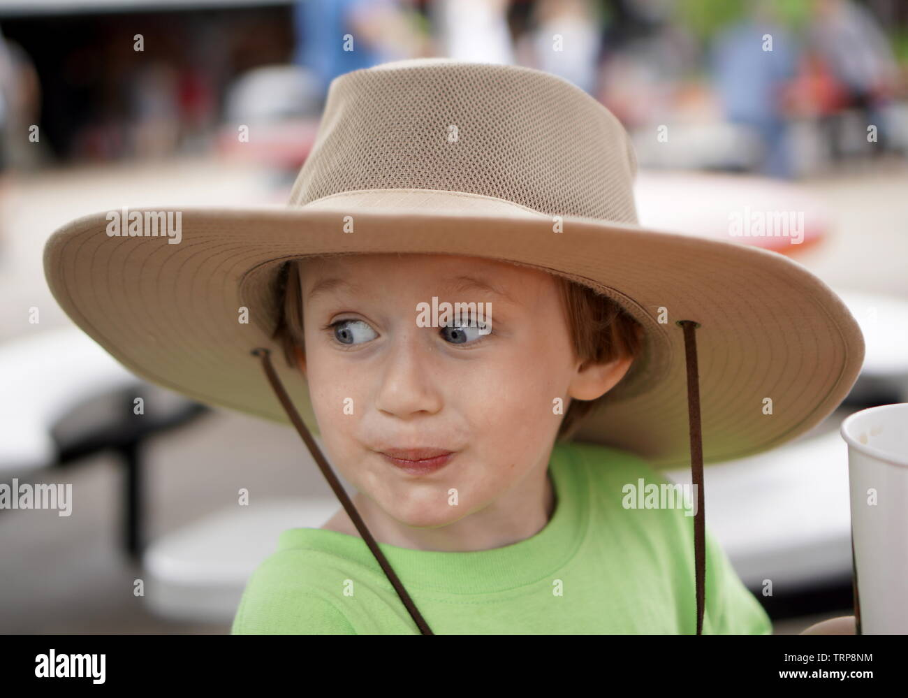 young girl with attitude and a hat - Stock Image