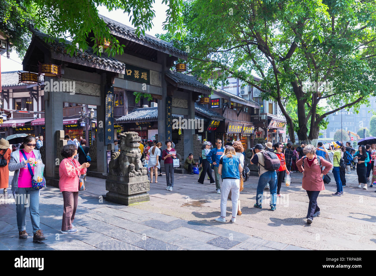 Tourists are walk for shopping in Ciqikou ancient town, a popular travel destination. - Stock Image