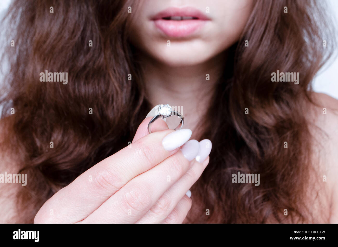 young beautiful woman holding engagement ring with a big diamond Stock Photo