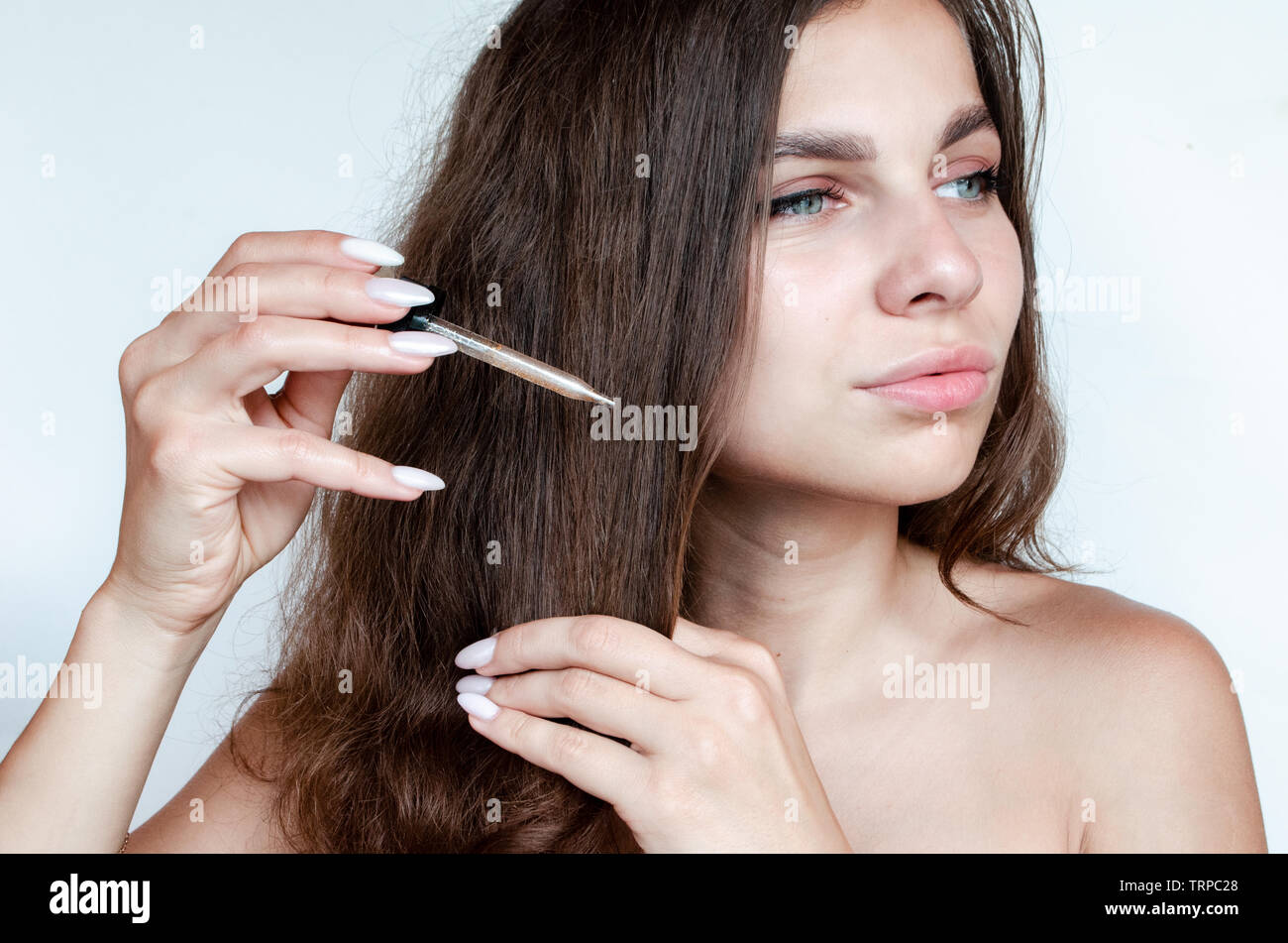 serum for hair on white background. The concept of hair care. Stock Photo