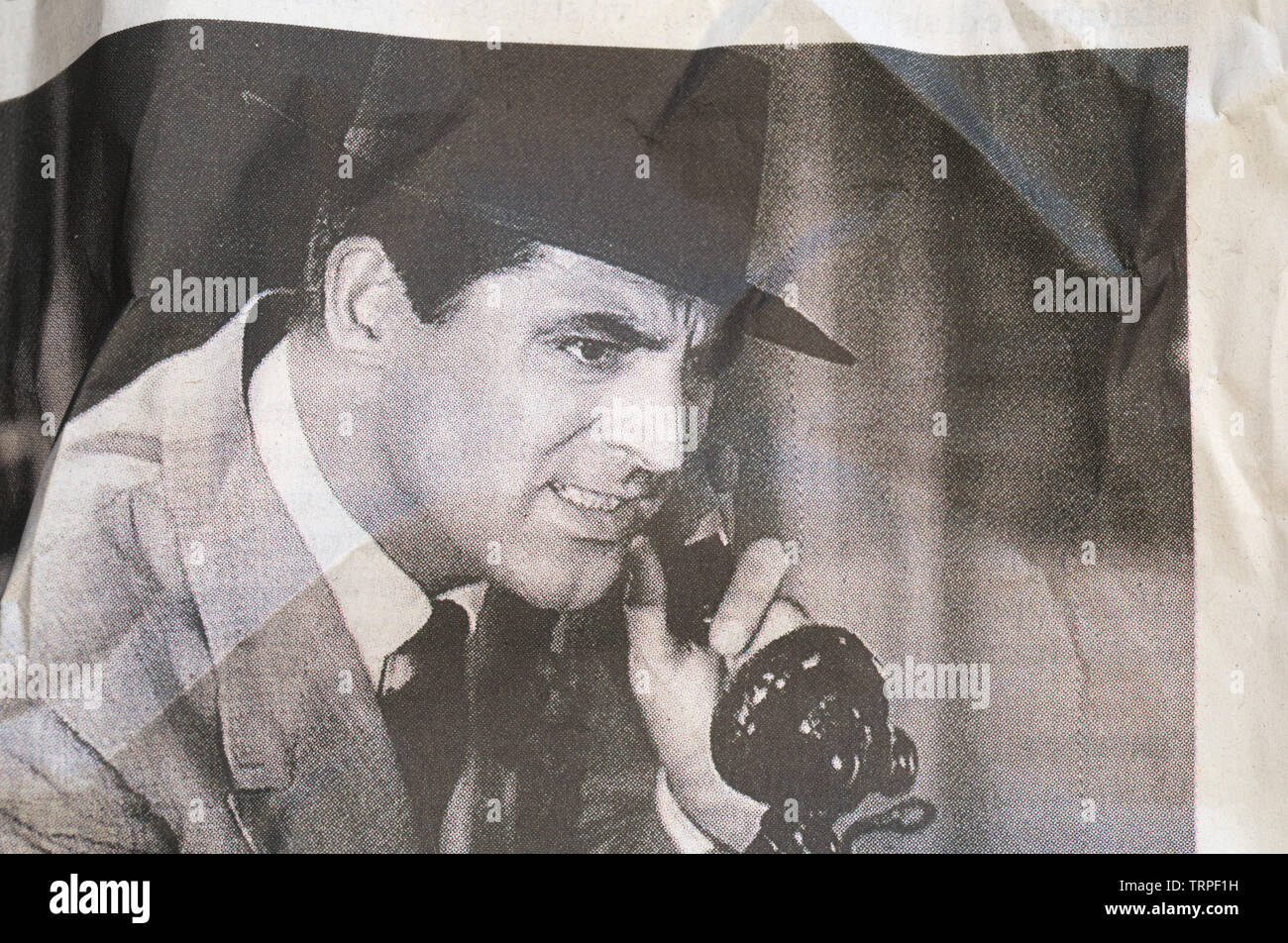 Cary Grant in 'His girl friday' in a crumpled newspaper print - Stock Image