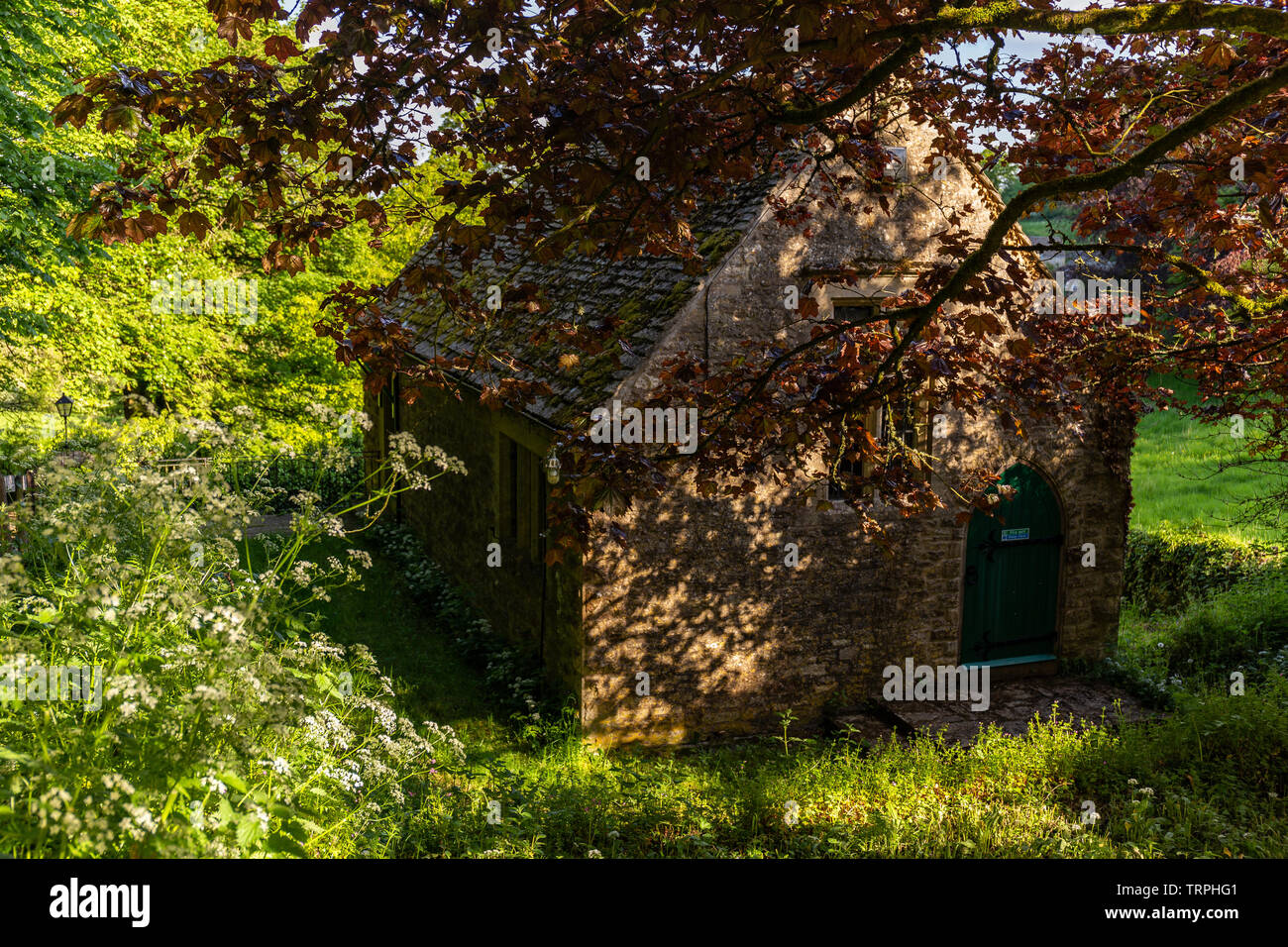 Old Cotswold Stone building on the outskirts of Edgeworth, Glocestershire. - Stock Image