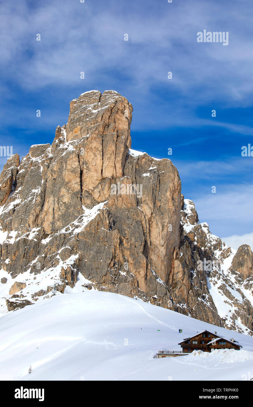 Chalet on the Dolomites mountain covered by snow, Belluno province, Italy - Stock Image