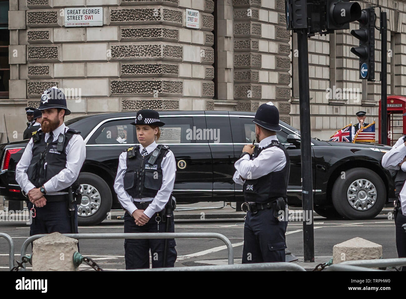 4 June, 2019. Donald Trump looks over at the protesters in Parliament Square from his limousine on Day 2 of his State Visit to the UK Stock Photo
