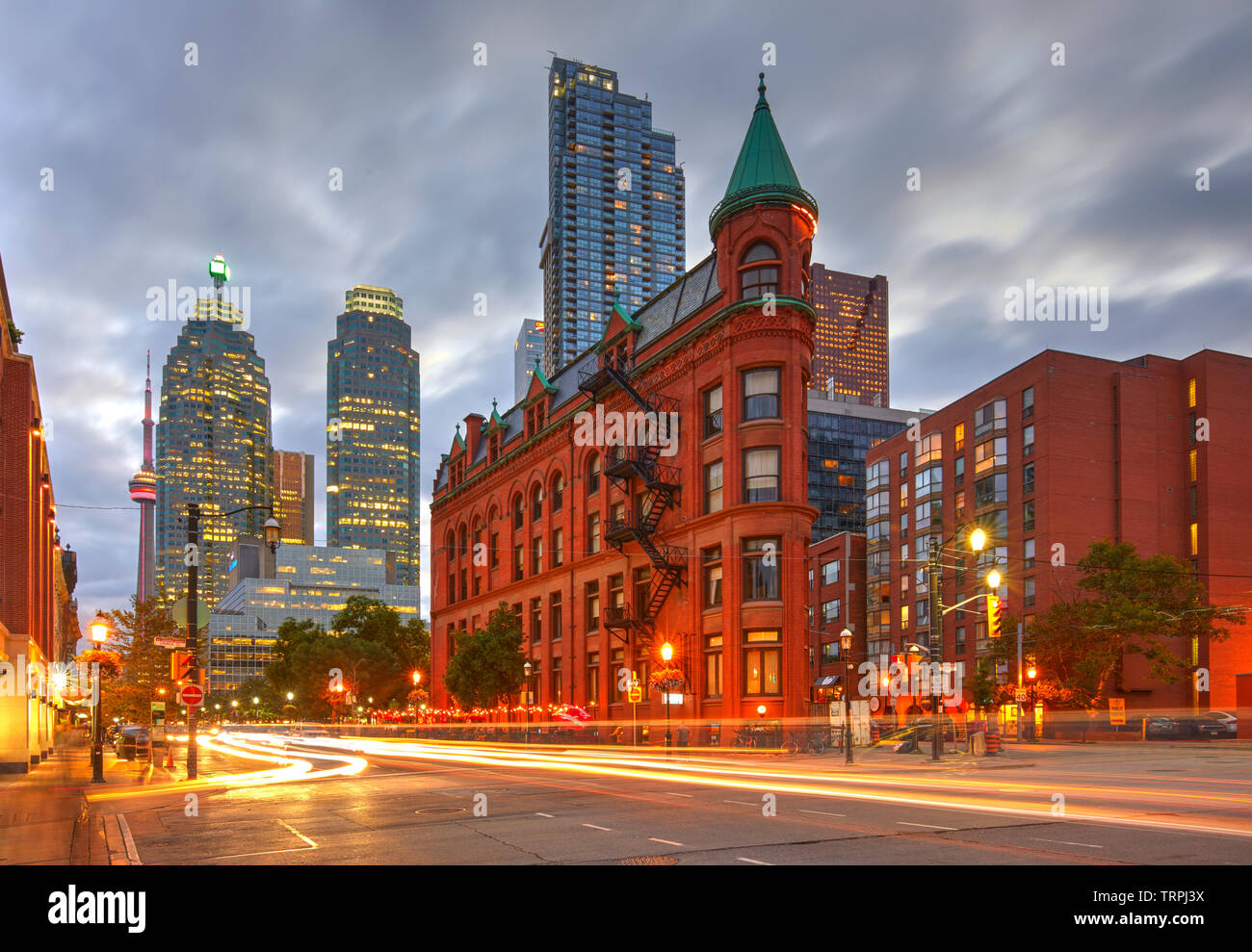 Gooderham Building, also known as the Flatiron Building, during the blue hour with light trails, Toronto, Canada - Stock Image