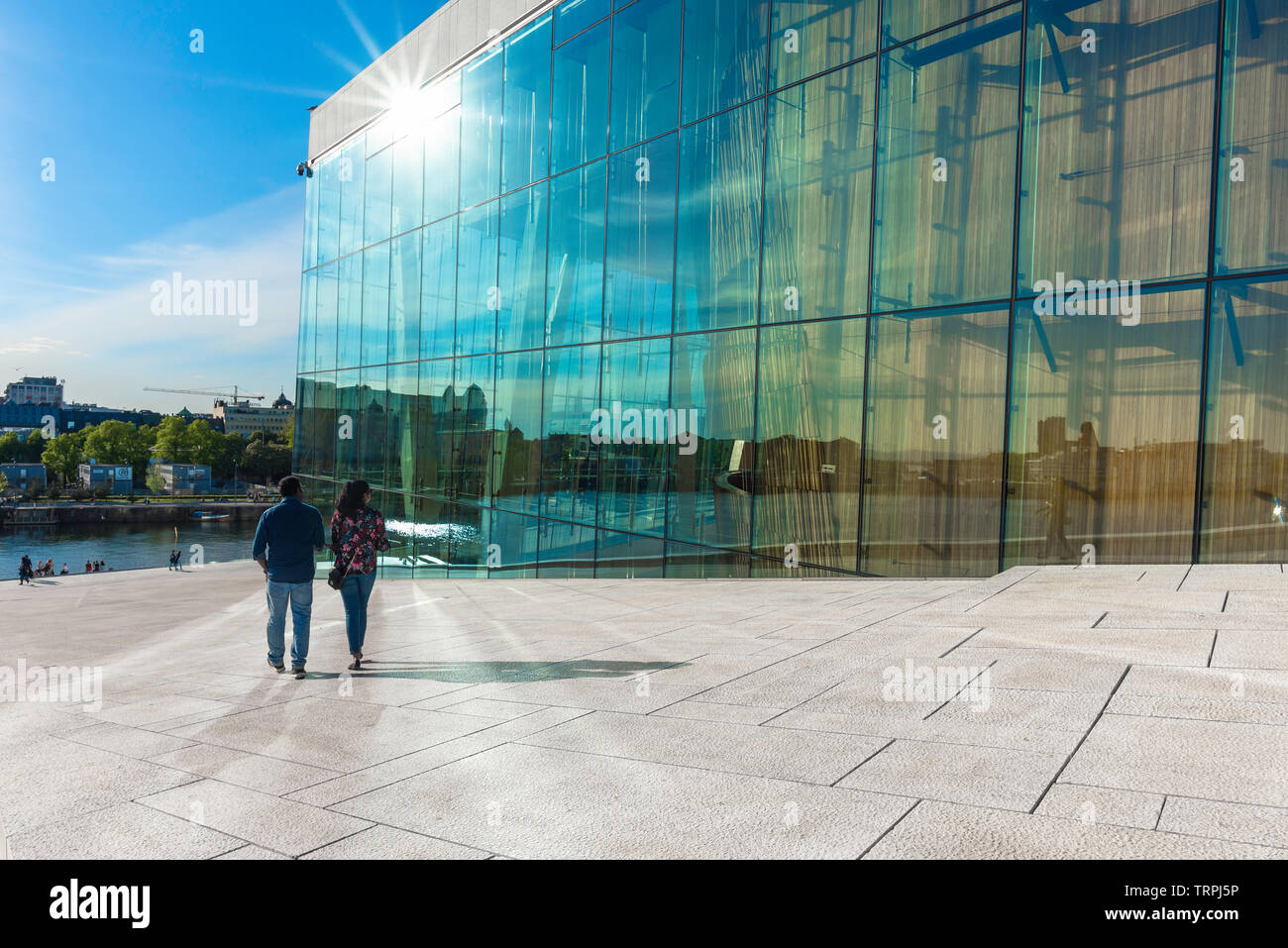 Oslo summer, rear view in summer of a tourist couple descending the vast access ramp leading to the roof of the Oslo Opera House, Norway. Stock Photo
