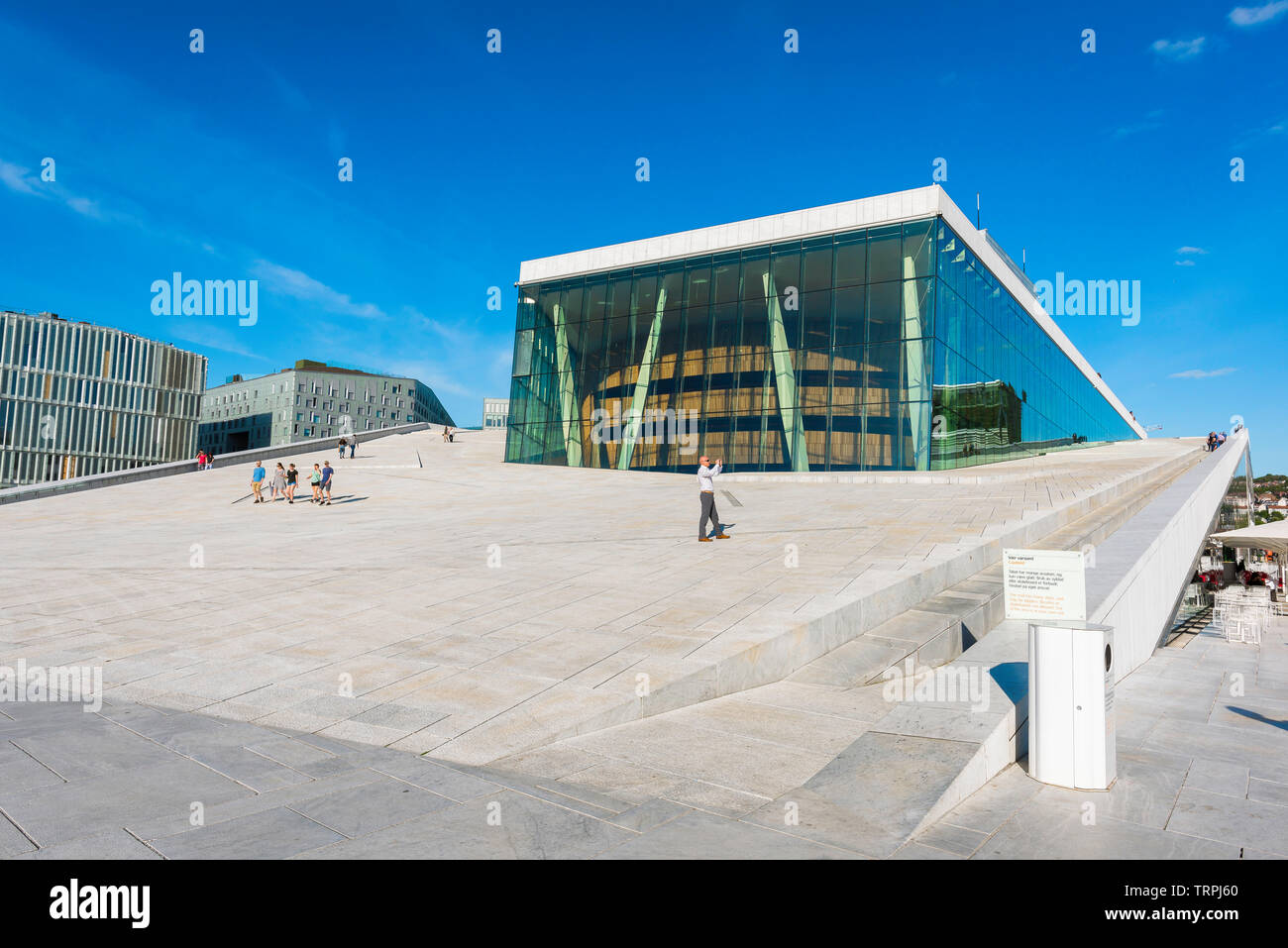 Oslo Opera House, view in summer of a tourist taking a photo while standing on the access ramp leading to the roof of the Oslo Opera House, Norway. Stock Photo