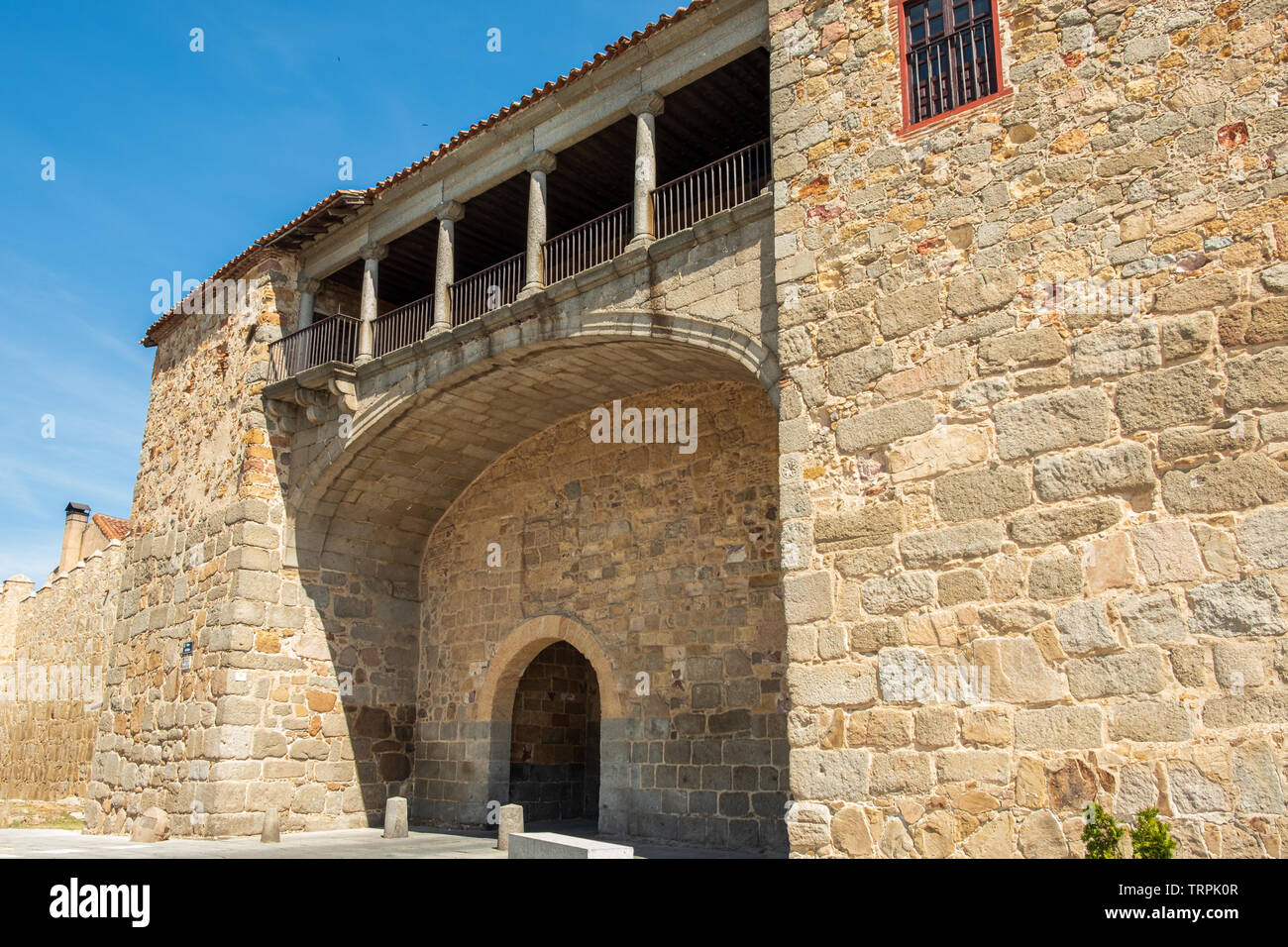 Walls surrounding Spanish city of Avila, detail of puerta del rastro or puerta de la estrella, attached to Palacio de los Davila - Stock Image