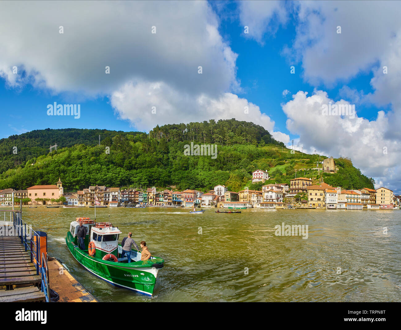 Pasajes de San Juan (Pasai Donibane), Spain - June 5, 2019. Fishing village of Pasajes de San Juan on a sunny day with the Boat crossing service docki - Stock Image