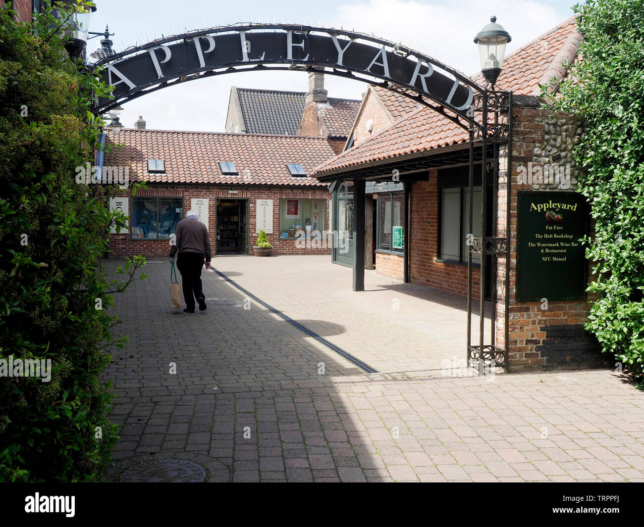 The Appleyard, a well designed redevelopment of small shops, cafes and offices behind the conservation area of the pretty Norfolk market town of Holt. Stock Photo