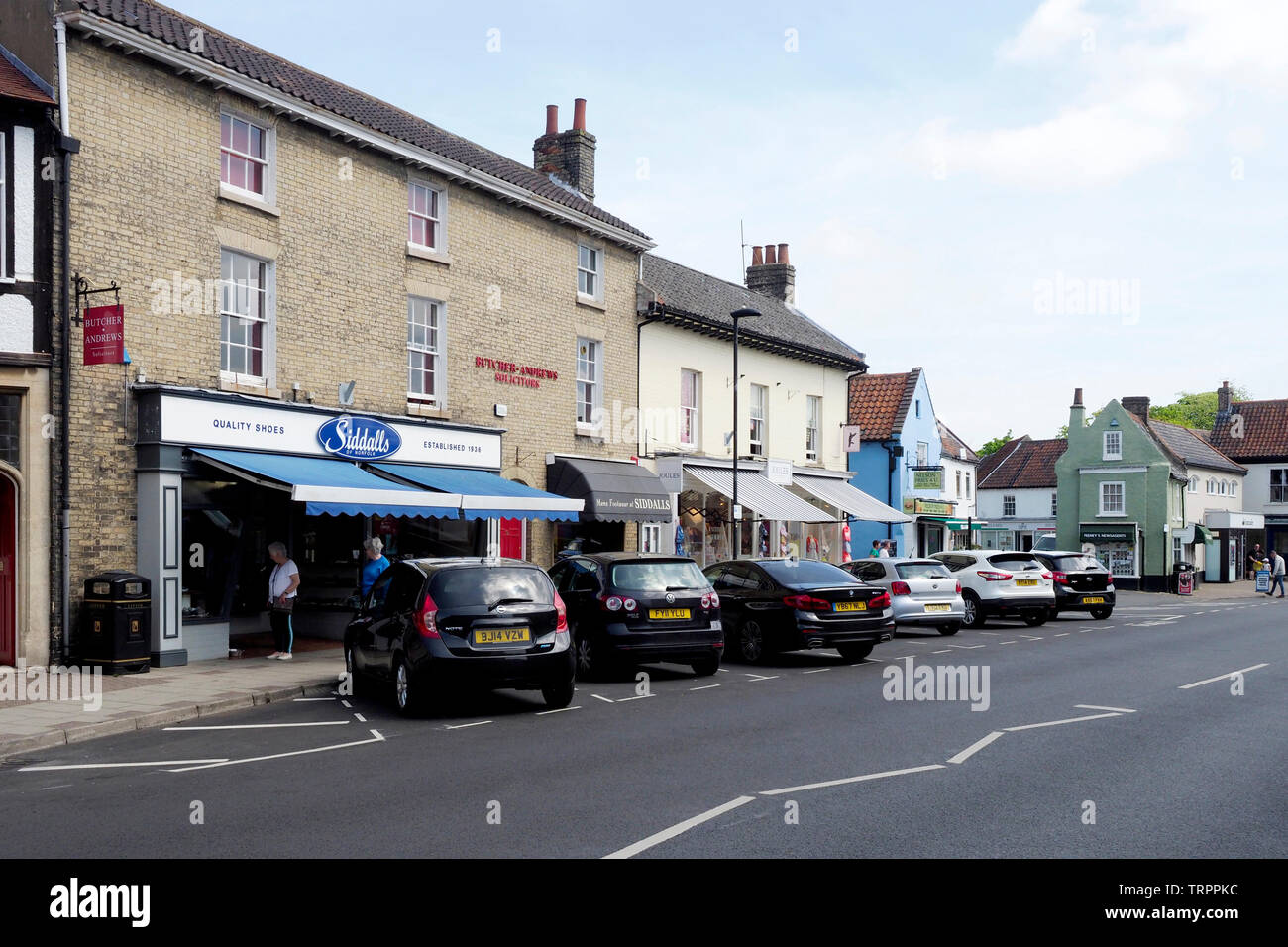 Quaint Georgian buildings in the North Norfolk market town of Holt, a thriving town attracting many tourists. Stock Photo