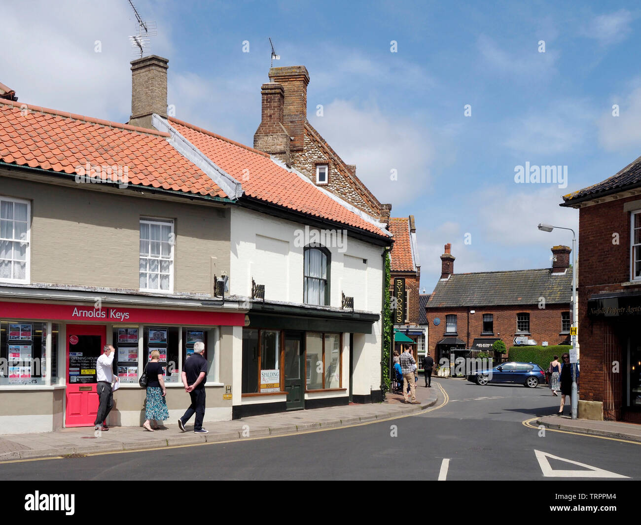 Looking into Byford Court from the High Street in the pretty North Norfolk market town of Holt with it's lovely Georgian buildings. Stock Photo