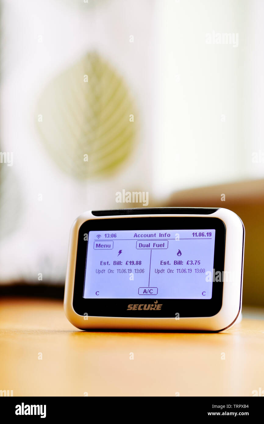 Smart Meter on cabinet showing energy readings - Stock Image