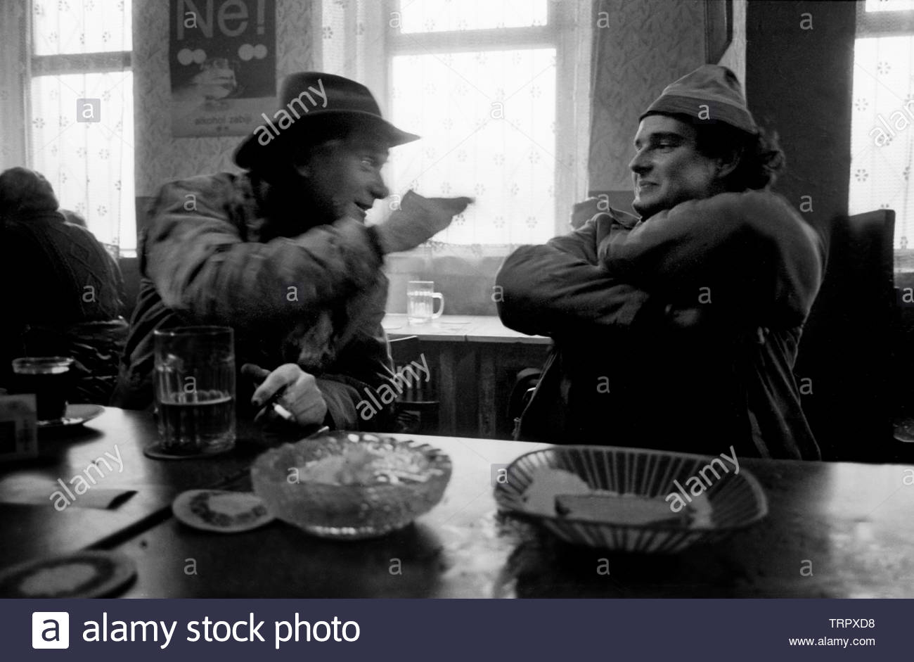 Czechoslovakia, Prague,1989 during the Velvet Revolution, the fall of communism in Eastern Europe. Tractor plant workers having just finished their night shift enjoy beer and bread for breakfast in a nearby bar. COPYRIGHT PHOTOGRAPH BY BRIAN HARRIS  © 07808-579804 Stock Photo